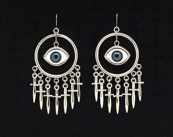 SHOOTING DAGGERS with her eyes, axe throwing, eyeball earrings, dagger, knife, sword, geometric earrings, sideshow style, carnival aesthetic