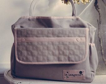nursery bag with changing mat and fasteners for any types of strollers