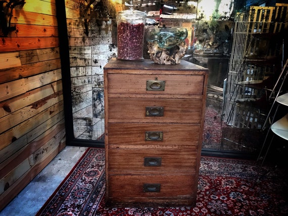 VINTAGE OFFICE DRAWERS : Wooden drawer unit with brass fold flush handles, possibly from a bank or post office.