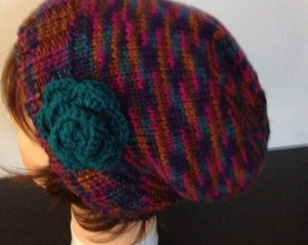 Woman's variegated slouchy beanie with decorative crocheted flower