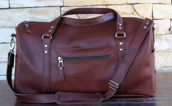 Leather duffle bag of italian red brown leather with four   Etsy 6120706e96