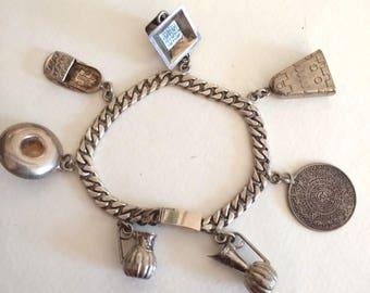 Vintage Castelan Mexican 925 sterling silver charm bracelet