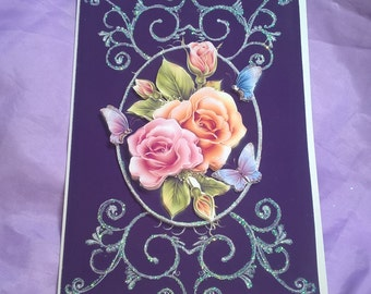 glittery floral birthday card with 3d roses and butterflies in pastel shades,a name age or family member can be added if you ask me .