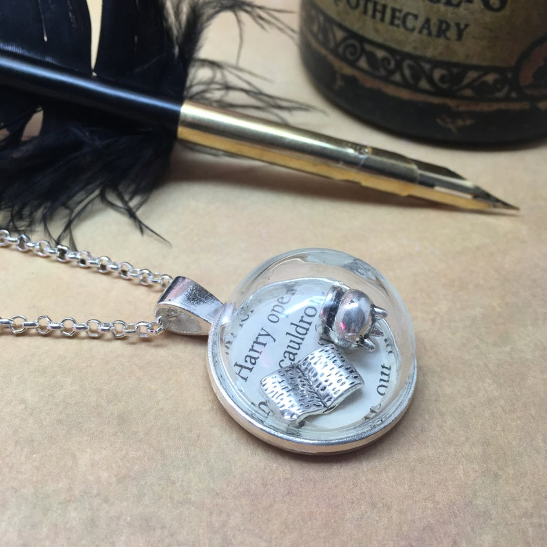 Potions Class  Glass dome necklace with old book page and image 0