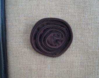 Gray zipper brooch