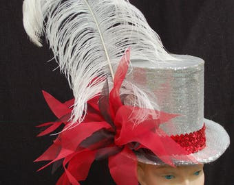 Silver top hat decorated with ostrich feather and organza