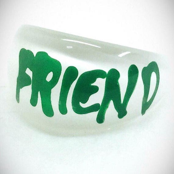 vintage lucite friend ring green writing white bac