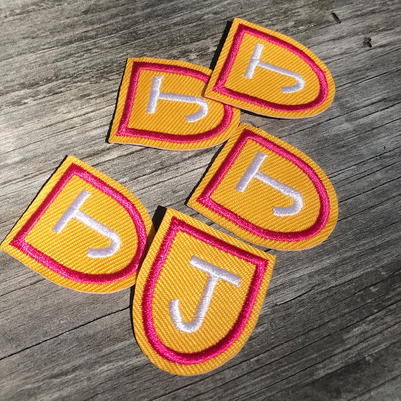 Embroidered letter J shape iron on patch One piece yellow hot pink and white