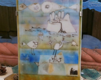 "Glass Wall Art - Fused glass picture in a stainless steel hanging frame titled ""Exotic Island"""