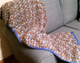 Very pretty larger size afghan, in varigated blue, brown, creme colors with nice accent blue trim  62.95