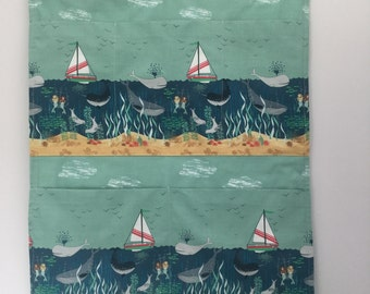 Handmade fabric pocket wall hanging, seascape fabric, children's bedroom, nursery or playroom