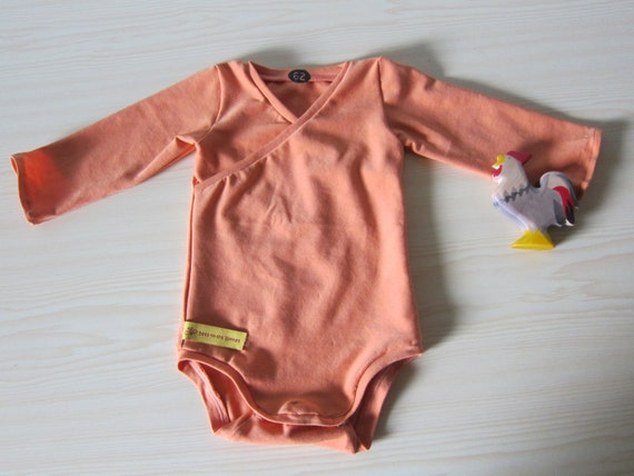 Sleeved Baby Body in Terracotta orange, organic Jersey size: 3-6 Mo.