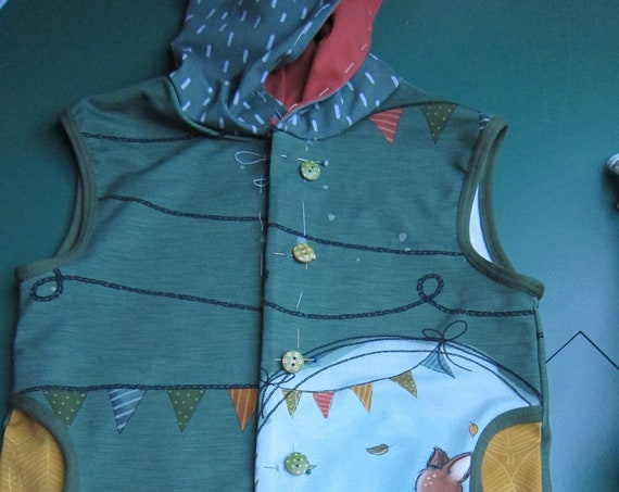 Toddler's Sleeveless Hooded Vest in Autumn colors organic cotton jersey various buttons.