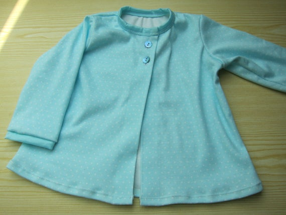 Baby blue dotted sweater in organic cotton jersey  in size 74cm / 9-12 mo