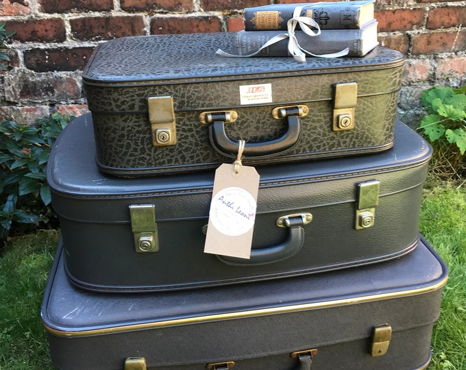 Featured listing image: Grey Vintage Suitcase Stack Set of 3 Suitcases Grey Home Decor Retro Luggage Stack Vintage Storage Solution Photo Props Interior Design