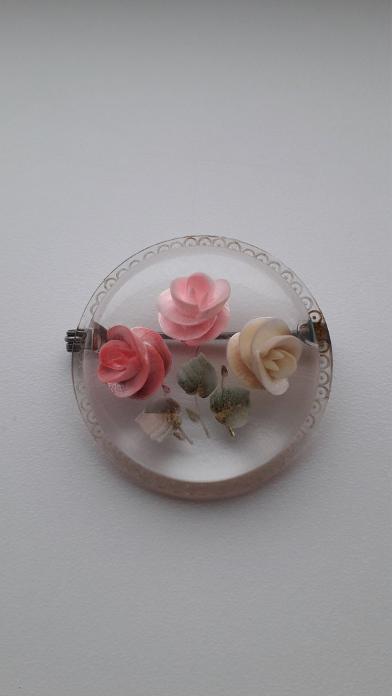 barrette translucent Lucite with intricate reverse carved roses and foliage Reverse carved Lucite hair clip Clips well. Perfectly clear