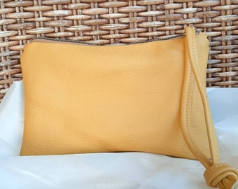 Genuine leather clutch with zipper closure and wristlet for everyday or evening. Leather bag, zipper pouch, leather handbag