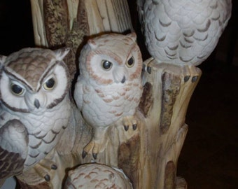 Porcelain Owls on Tree Stump