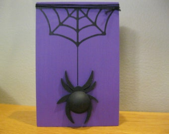 Halloween Wood Block Decoration painted purple with black spider-web and black 3-D spider attached.  Wrapped with black floss.