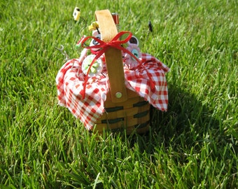 Picnic Button Bouquet Popping out of a picnic basket with checked cloth and button flowers with picnic fixings and a busy bee and ant button