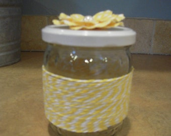 Yellow and White Wrapped Jar with Flower