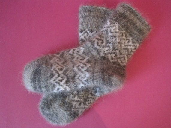 New hand knitted baby socks made from natural goat down.