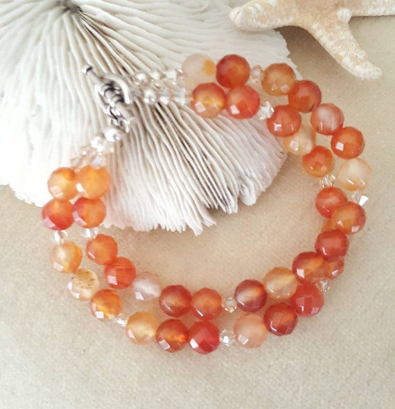 Carnelian double strand bracelet! Handcrafted with Sterling Silver and sparkling Swarovski crystals! Warm oranges and reds! Like a sunset!