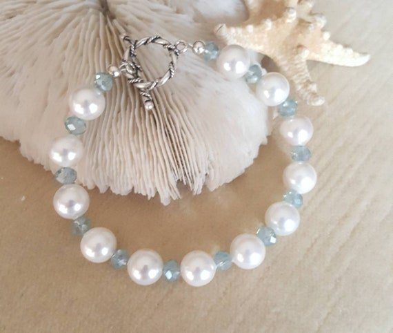 Pearl & Crystal Bracelet! Handcrafted with beautiful white pearls, sparkling blue crystals, and Sterling Silver! Stunning combination!