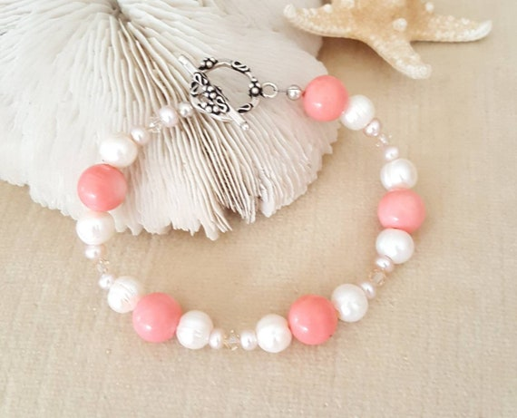 Coral & Pearl Bracelet! Handcrafted with genuine Coral, 2 styles of Freshwater Pearls, Sterling Silver, and twinkling Swarovski crystals!
