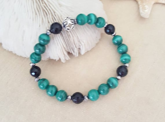 Malachite & Black Onyx Stretch Bracelet! Handcrafted with silvery crystals and one intricately detailed Sterling Silver bead!