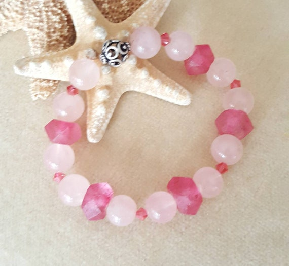 Rose Quartz & Pink Sea Glass Stretch Bracelet! Handcrafted with sparkling Swarovski crystals and a single Sterling Silver bead!