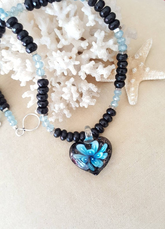 Vintage Heart Necklace!The heart is vintage glass! Handcrafted with Black Onyx, vintage brass beads, & sparkling blue crystals!