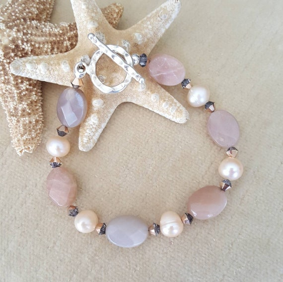 Sunstone & Pearl Bracelet! Handcrafted with Sterling Silver and sparkly Rose Gold Swarovski crystals! Faceted Sunstone and champagne pearls!