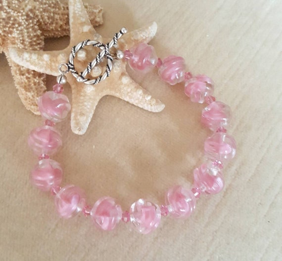Vintage German glass bracelet! Pink Vintage beads circa 1930's!Handcrafted with Sterling Silver and twinkling pink Swarovski crystals!