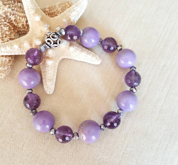 Phosphosiderite & Amethyst Stretch Bracelet! Handcrafted with silvery crystals and one intricately detailed Sterling Silver bead!