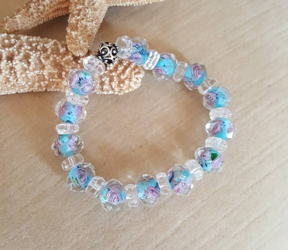 Lampwork & Clear Quartz Stretch Bracelet! Blue and pink floral design.  Handcrafted with a single Sterling Silver bead!