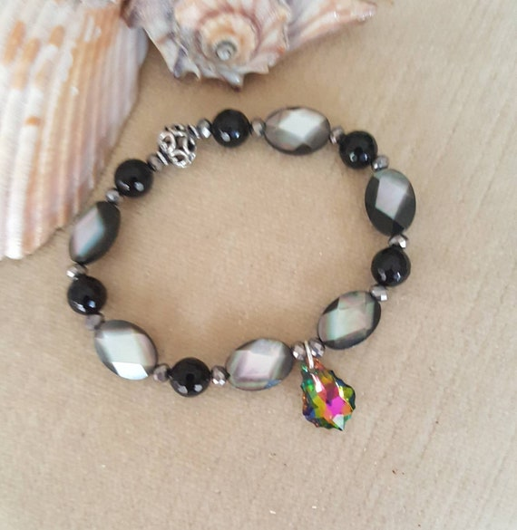 Black Lipped Mother of Pearl & Black Onyx Stretch Bracelet! Swarovski Crystal Charm, one Sterling Silver bead, and silver crystals!
