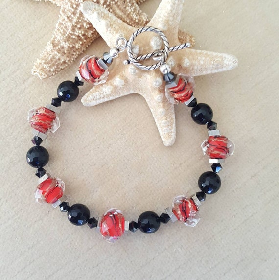 Black Onyx & Red Lampwork Bead Bracelet! Handcrafted with Sterling Silver, Swarovski crystals, and vintage brass beads!