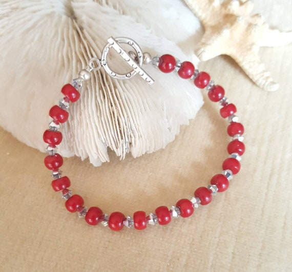 Brilliant Red Coral, silvery Swarovski crystals, & Sterling Silver Beaded Bracelet! Genuine coral of deep red and dazzling silver crystals!