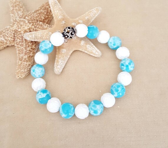 Aqua Terra Jasper & White Carved Shell stretch bracelet! Handcrafted with a single Sterling Silver bead! Stunning Blue and white combination