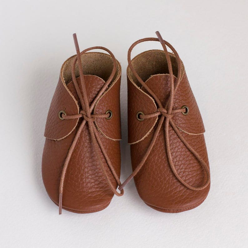 6d7f3e39a4fa2 Choose colorBrown baby moccasins with shoe laces. Newborn | Etsy