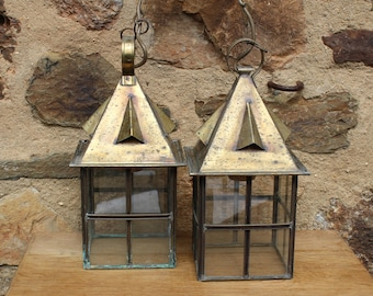 A Pair of Vintage Brass and Glass Panelled Hanging lanterns