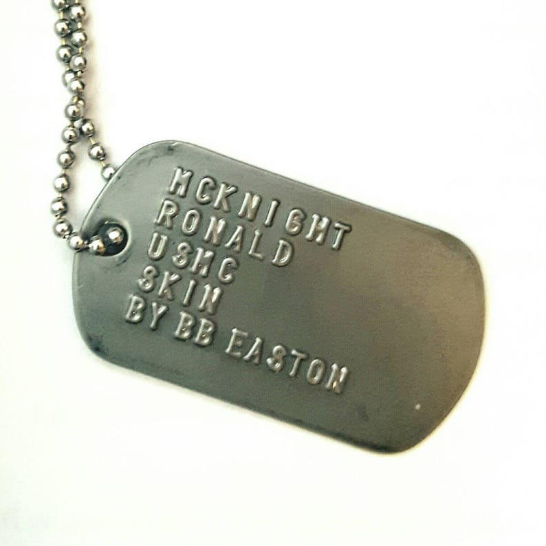 Ronald McKnight dog tag bookmark  from the novel SKIN by BB image 0