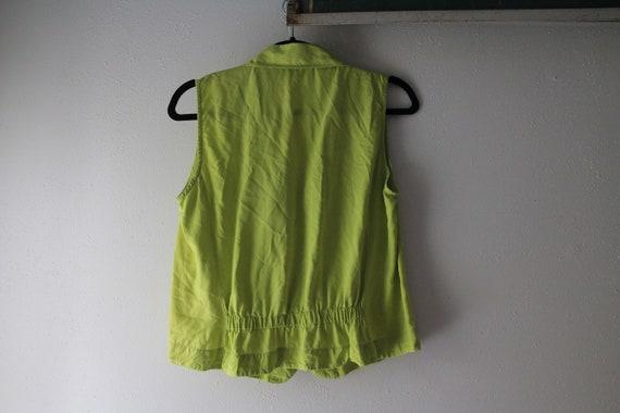 Green silk sleeveless blouse