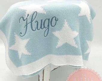 Personalised Baby Blanket in pale blue with white stars and border. Lovely cotton knit blanket perfect for new baby or baby shower gift