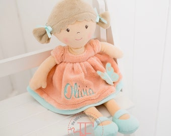 Personalised brown haired soft rag doll wearing fleecy peach dress with butterfly motif