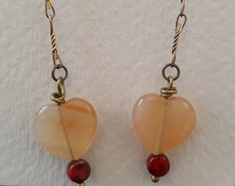 Antiqued brass heart shaped beaded dangle earrings