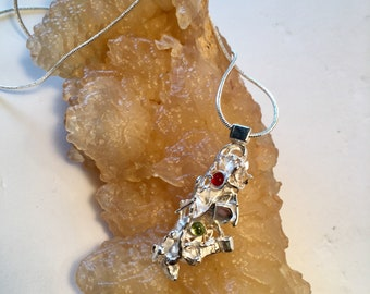 Brutalist silver pendant with peridot and carnelian