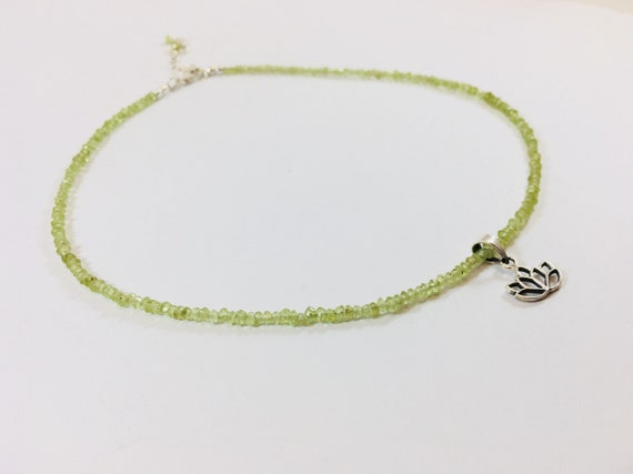 Peridot bead silver charm necklace