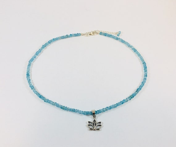 Blue topaz silver charm necklace